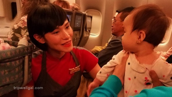 Taipei Flight attendant assisting a baby in one of those new places