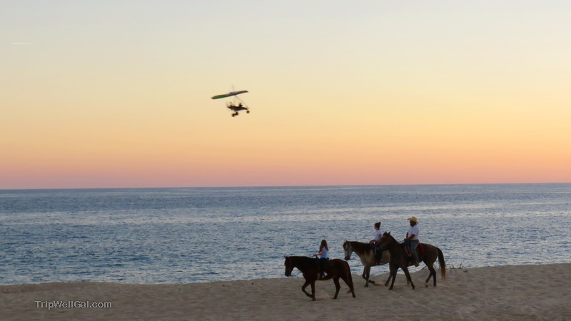 Horseback riding and an ultralight pass by along the corridor in Cabo San Lucas