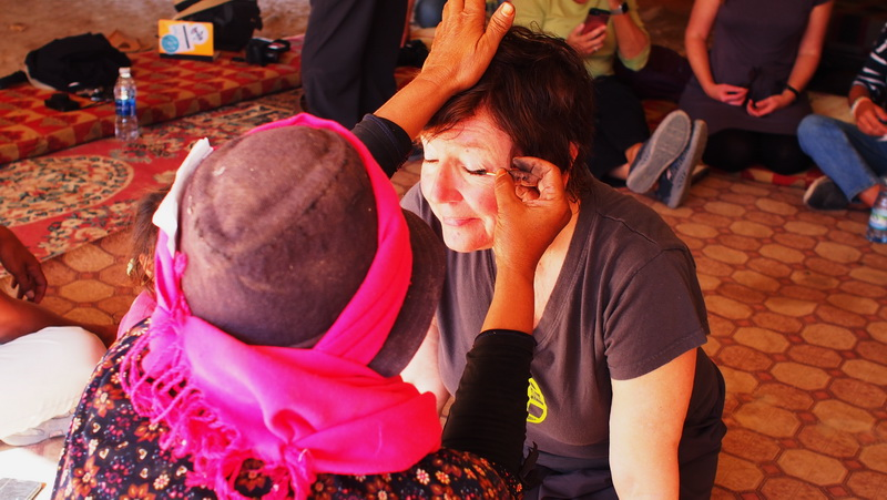 Having my eyes smudged with Kohl in the Bedouin tent