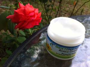 open jar of arnica cream
