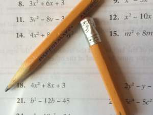broken pencils on an algebra book
