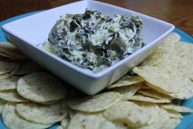 This hot spinach artichoke dip comes together in the slow cooker for a perfect appetizer!