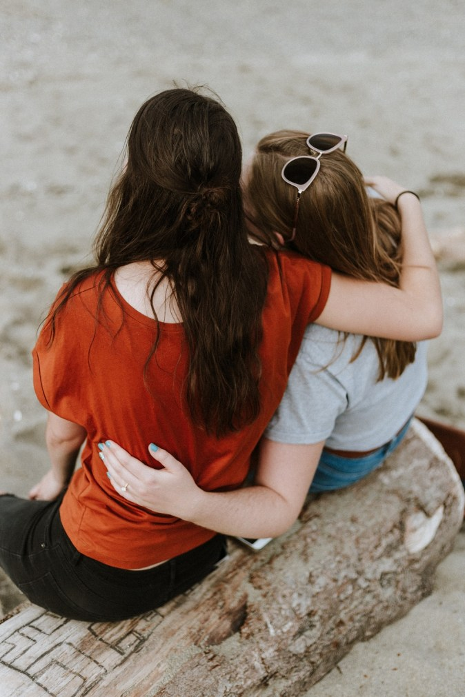 sobriety and relapse pic: two women sitting side by side with arms around one another supportively