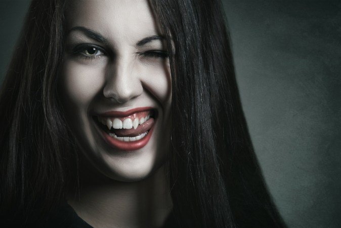 sobriety and relapse pic: girl with fangs like vampire, smiling
