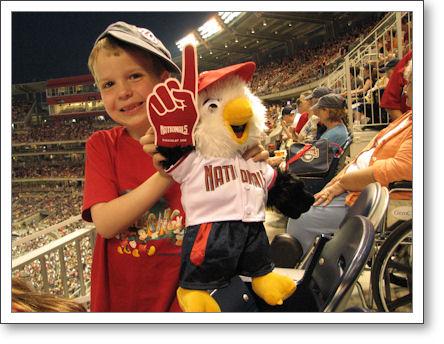 BoyZilla got his very own Nationals mascot, Screech. Note the miniature foam finger. Like boy, like bird.