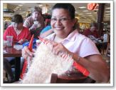 Sylvia is knitting a shawl on Speed Stix