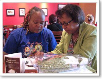 Yvonne helps Lorna with a crochet pattern