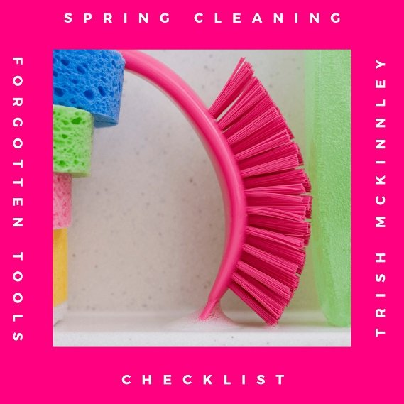Picture of pink cleaning brush with 'Spring Cleaning Forgotten Tools Checklist by Trish McKinnley' written around in