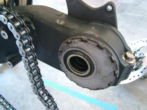 Please post a step by step to lube the rear wheel bearings
