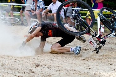 man falling off a bike