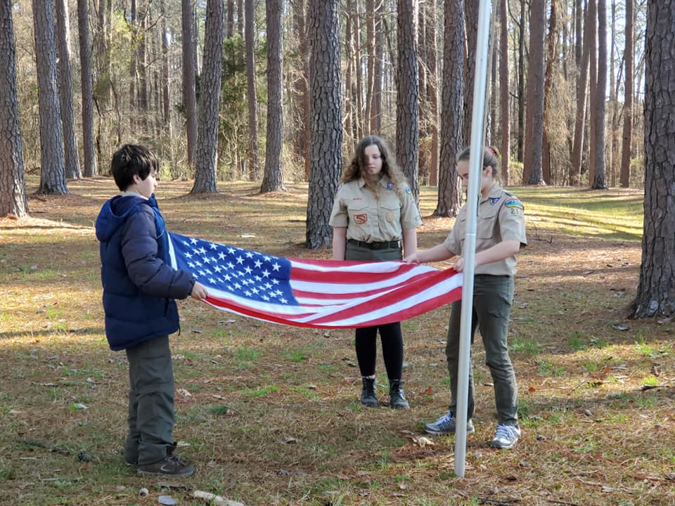 Girls Folding Flag