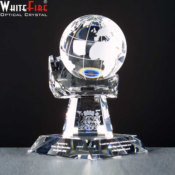 Whitefire Crystal Globe In Hand Awards Supplied In A Velvet  Lined Presentation Case. Price Includes Engraving.
