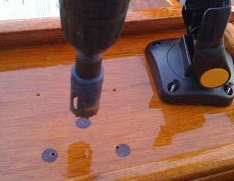 Preparing to drill a one-inch hole in the to of my mahogany Whaler console