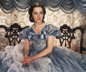 Olivia de Havilland as Melanie Wilkes by studio publicity still (London Evening Standard) [Public domain], via Wikimedia Commons.