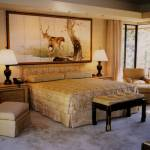 Done as a principal with Edward J. Perrault Design Associates, a bedroom in Pebble Beach, CA, featuring custom designed furniture with an antique Japanese screen.