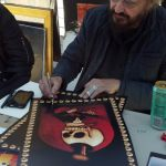 Stanley Mouse signing Bossman posters