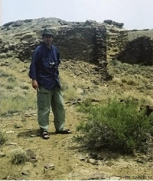 Derek at Kinbineola Ruins at Chaco Canyon - Truck Camper Adventure