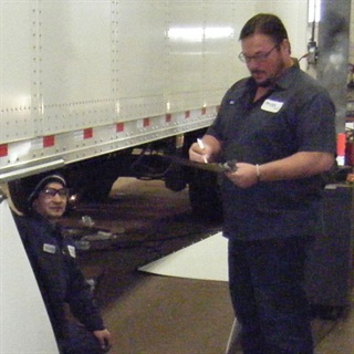 Sometimes it's necessary to crawl under the trailer to inspect undercarriage components.