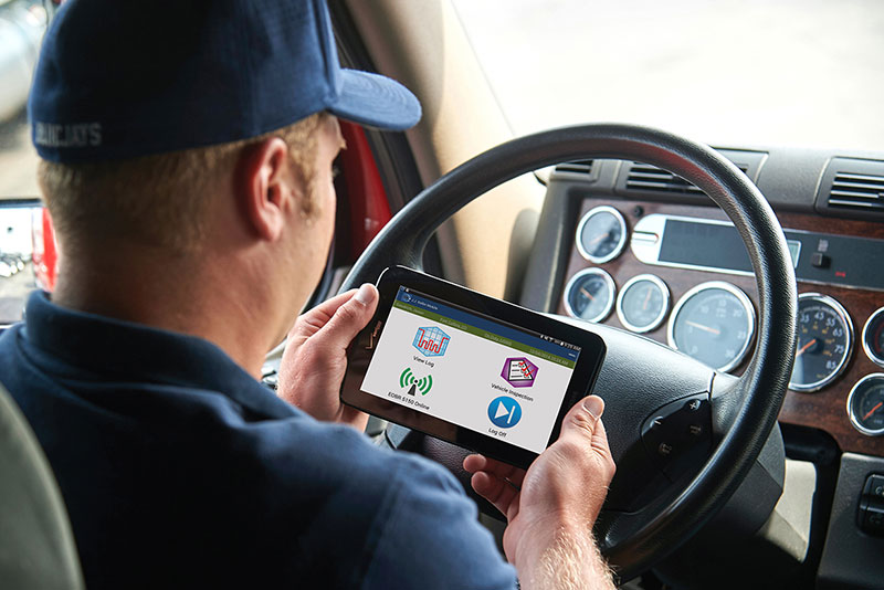 Driver with his tablet looking at his log screen.