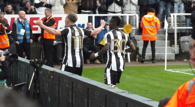Ritchie and Atsu celebrate in front of the Gallowgate/Milburn corner