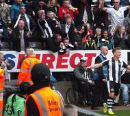 Ritchie celebrates his winning goal against Wigan in fornt of the Gallowgate/Milburn corner