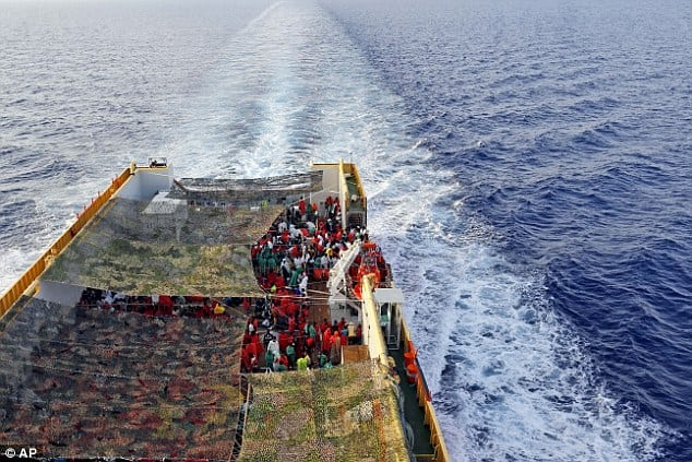 AP images. A ship carries asylum seekers to Italy