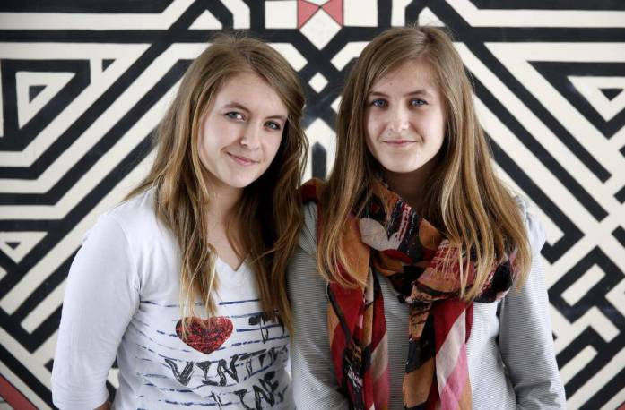 Twins Dzenisa and Merisa Kaukovic pose for a portrait at a secondary school in Buzim