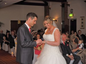 Exchanging the rings at Carden Park Wedding Ceremony