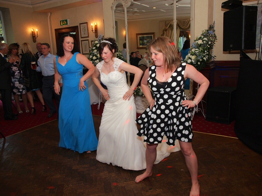 Bride having fun in evening reception with her friends and bridesmaids