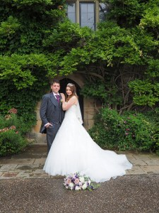 The bride and groom in the gardens of Chirk Castle
