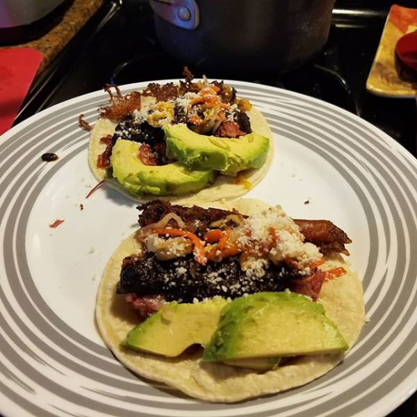 Pasture raised duck confit tacos with homemade mole sauce,  homemade curtido, fresh avocado,  and cheese crisped in duck fat. No language but tacos can communicate my boundless love and adoration for @leahmariecurran on her birthday.I 🌮 you forever,  my love!
