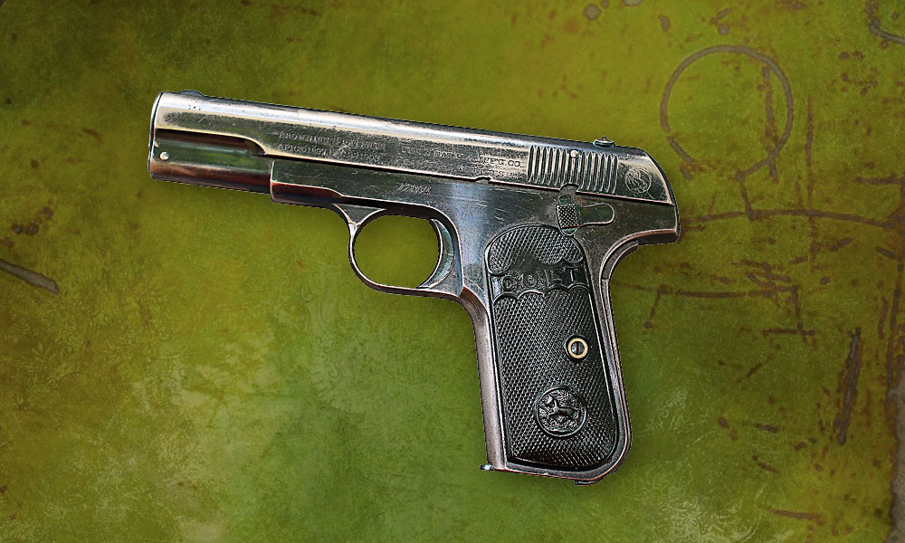 As with other Colt automatics to date, the 1903 Hammerless was a John M. Browning design, with a Dec. 22, 1903, patented improvement which covered the concealed hammer. Early '03s, like this circa 1905 example, had 4-inch barrels. Starting wi th ser. no. 72,000, guns had 33⁄4-inch barrels. – Phil Spangenberger collection –