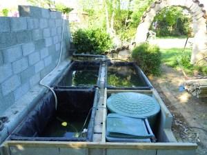 Bassins à truites, filtres et bassin tampon