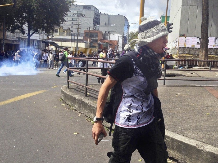 A protestor supporting poor farmers confronts police in Bogotá last year. ©2013 Chris Allbritton