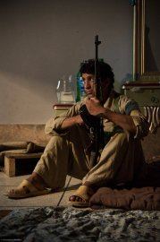 A 16-year-old member of a security detail and a tribal militia in Swat Valley near Mingora, Pakistan, relaxes for a few quiet moments in the captured house of a Taliban commander on Sept 29, 2009. The Pakistani Army has been urging the formation of these tribal militias to combat the Islamic militants bedeviling the frontier and tribal areas of Pakistan.