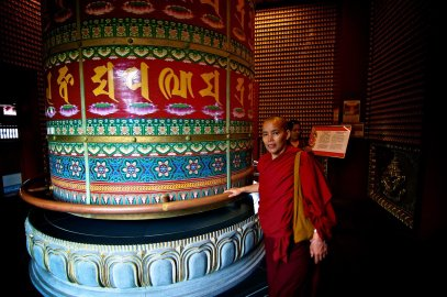 Buddhist devotees walk the prayer wheel on the roof of the Buddhist temple in Singapore's Chinatown.