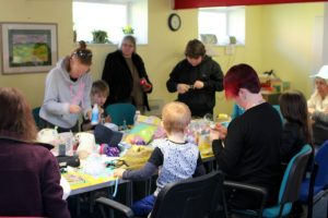 TDC volunteers help with community arts and crafts