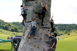 Young people on rock climbing tower
