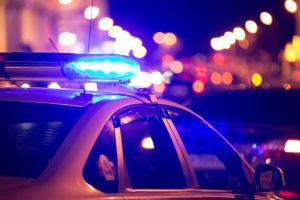 Police car at a crime scene making an arrest