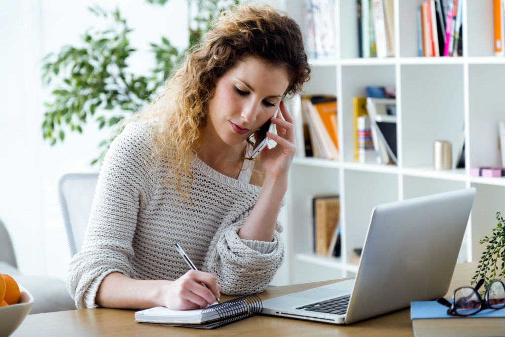 Person calling previous employers to confirm work history