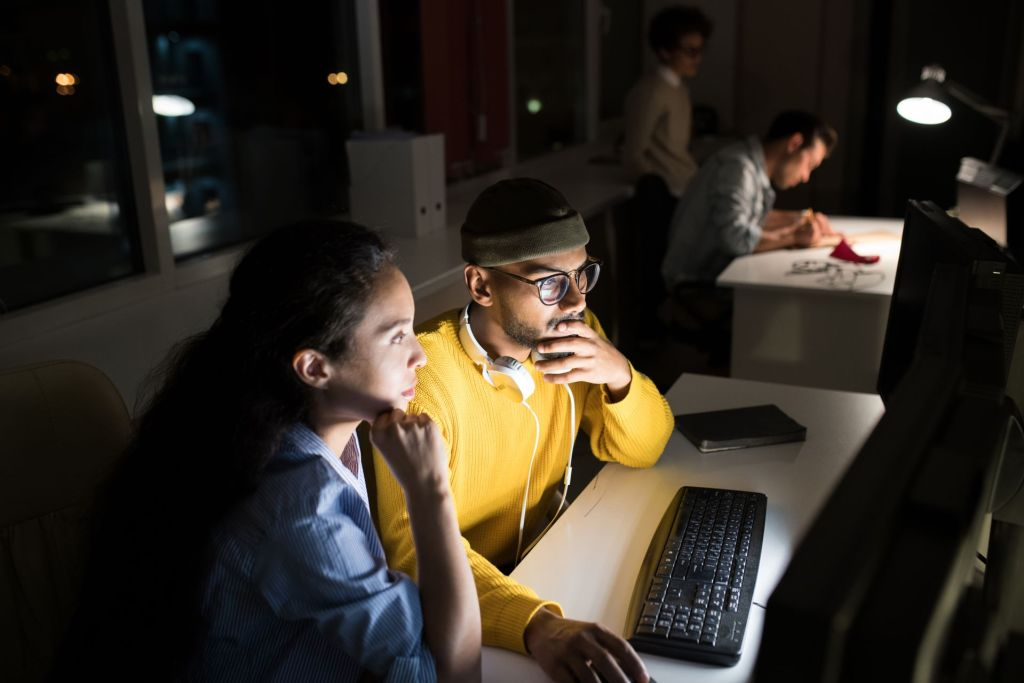 Startup business team staying up late to work on a project
