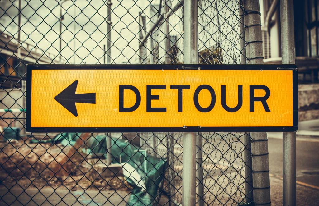 Detour sign alerts drivers that there's a way to avoid upcoming roadblock