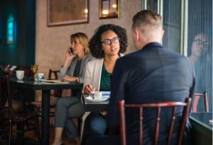 Business owners meeting to discuss background check results at a coffee shop