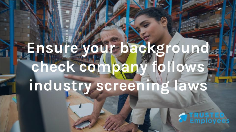 "Photo of workers looking at a computer with the words ""Ensure your background check company follows industry screening laws"""