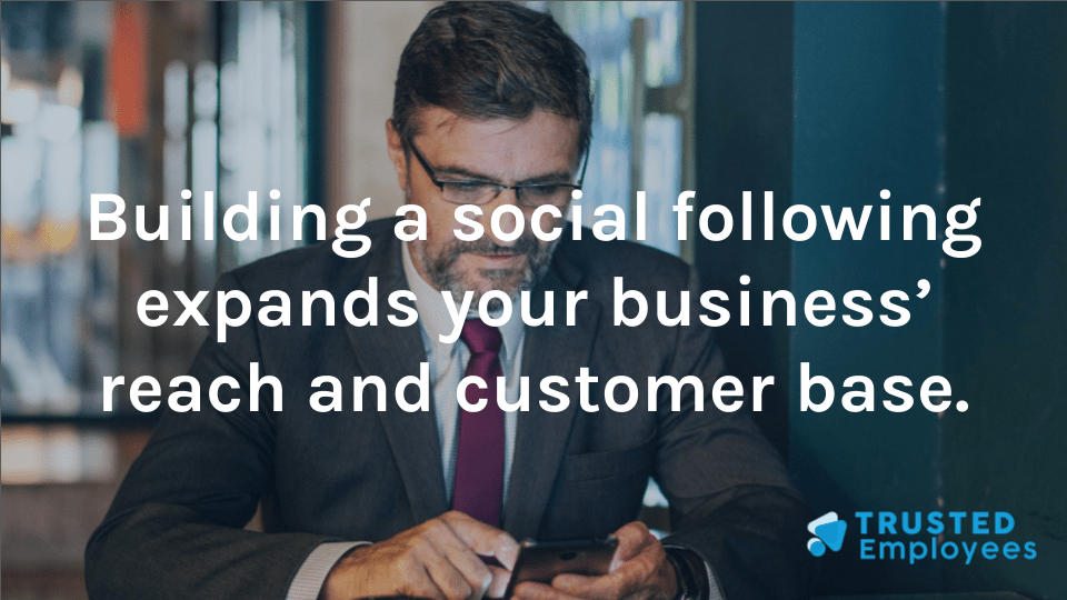 Business owner using a social media account on their phone to build their client base