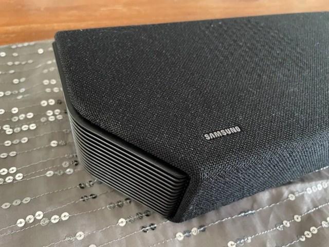 The Samsung Q950A combines felt and metallic grilles in its exterior design.