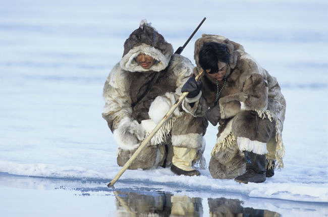 inuit ice fishing, caribou fur