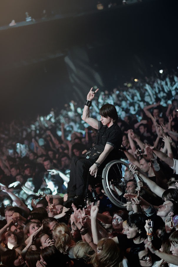 Fans holding a disabled friend in concert in Moscow.