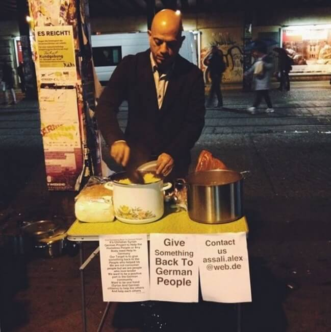 15. Syrian refugee hands out food to the homeless in Germany to 'give something back.'