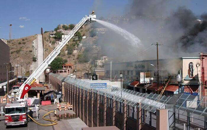 Firefighters In Arizona Putting Out A Fire In Mexican Border.